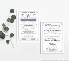 a wedding program template in black and lavendar on a table with greenery mounn modern life