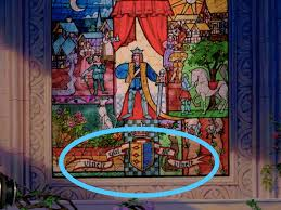there s a very poignant latin phrase on the stained glass windows in the 25th anniversary blu ray edition of the it s revealed that