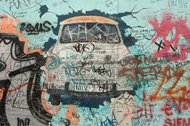 in this painting by artist birgit kinder the east german trabant crashes through the berlin on famous berlin wall artists with ap explore berlin wall 25th anniversary