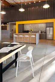 Love the wall tile, clean lines and pop of color- Office design office  Cuningham