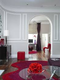 gray walls and red accents living room contemporary with accent color tufted area rugs