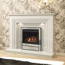 ivory colored travertine is used for the surrounding space while the interior of the fireplace is made of light limestone tiles laid in brick