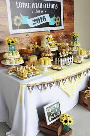 Add some brightness to your graduation party dessert table by decorating  with cheery yellow sunflowers.