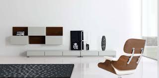 Simple Modern Living Room Living Room Brown Chair White Wall Mini Bookcase Rug Tile Floor