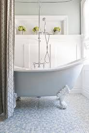 view in gallery painted clawfoot tub and mulitcolored penny flooring give this bathroom a tranquil vibe