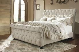 Willenburg Linen Cal King Upholstered Sleigh Bed from Ashley