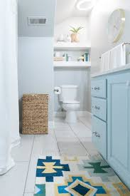 dark green bathroom accessories. kids bathroom remodel with pops of light turquoise, yellow, and green dark accessories h