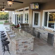 patio kitchen with bar sink and mini fridge
