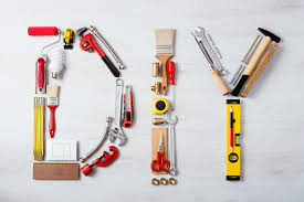 diy word composed of work and construction tools on a wooden surface top view hobby