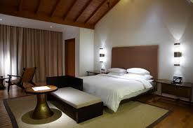 white bedroom with dark furniture. Masculine Bedroom With Dark Furniture Wood Floor And White Walls Bedding Closet