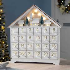 35 5 cm pre lit wooden village scene advent calendar decoration white