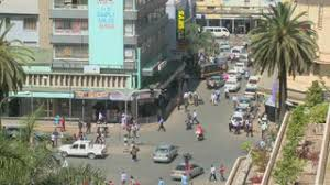 wide angle view busy design office. subscription library pedestrians walk on busy streets in nairobi kenya wide angle view design office