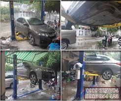 Máy rửa xe áp lực cao | Máy rửa xe cao áp: Cầu nâng 2 trụ giằng dưới giá bao  nhiêu tiền