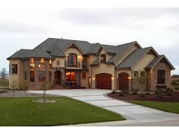 rustic european luxury home with wrought iron accents and stonework