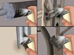 how to adjust a garage door spring