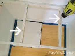 mylove2create hall closet makeover drilling holes to attach bench seat
