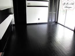 imposing design of painted hardwood floors in black paint color with white walls