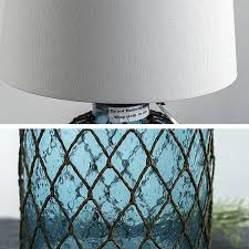 north rattan web and blown glass bottle flax shade table lamp 11