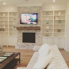 brick should be more red ditch the tv maybe shiplap above mantle