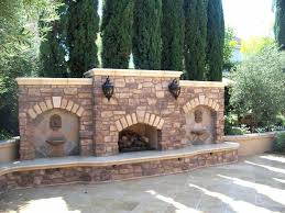 building your own outdoor fireplace meval castle styled luxury outdoor fireplace idea with seating wall build