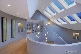 high tech lighting. modern hallway with hardwood floors, high ceiling, tech lighting crescendo chandelier