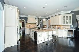 traditional kitchen with white sand granite counters and white cabinets