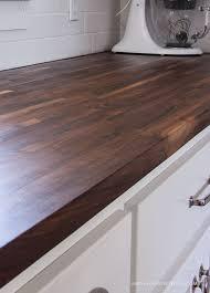 walnut butcher block countertops on white cabinets