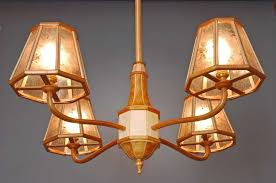 wood chandelier in cherry birds eye maple and mica