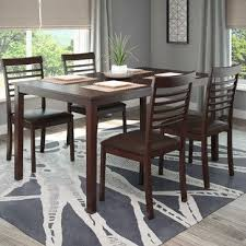 add fort to your dining room with this transitionally styled five piece dining set from corliving this set includes four dining chairs with chocolate