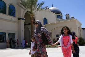 a family came out of the new mosque after attending friday prayers