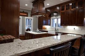 Quartz Versus Granite Kitchen Countertops White Kitchen Cabinets Versus Brown Quicuacom
