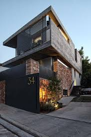 modern home architecture stone. View In Gallery Sleek Athens House Blends Stone With Concrete Textures 1 Facade Angle Thumb 630x947 26214 Modern Home Architecture