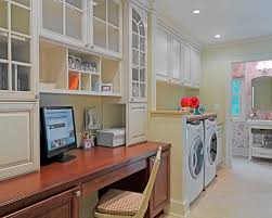 laundry room office. example of a classic utility room design in dc metro with raisedpanel cabinets laundry office p