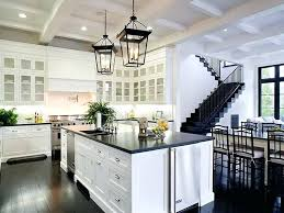 white kitchen cabinets with black countertops kitchen white cabinet ideas varnished wood hardware antique wrought iron bar stools high gloss black wooden