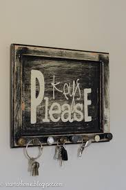 This sign is made out of an old cupboard door with miss match knobs key  holder