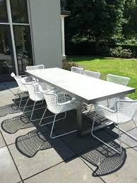 modern concrete patio furniture.  Furniture Modern Patio Furniture A Concrete Table And White Metal Chairs For  Simple Dining Space In Modern Concrete Patio Furniture E