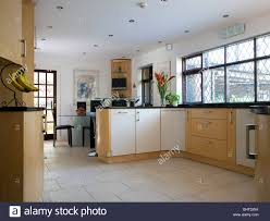 Country Kitchen Floors Limestone Floor Tiles In Modern Country Kitchen Dining Room Stock