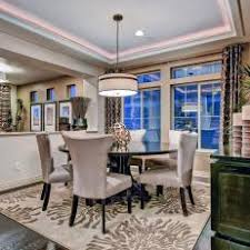 Dining Room With Tray Ceiling Lighting