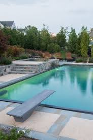 impressive above ground swimming pools in pool contemporary with plunge pool hot tub next to exposed aggregate concrete pool deck alongside hot tub