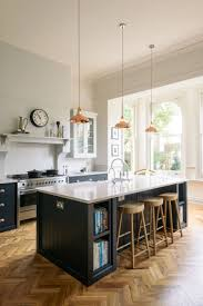 Copper Pendant Lights Hang Above A Beautiful Big Island In
