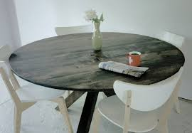 black distressed round dining table