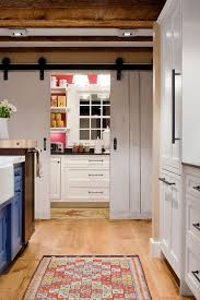 view in gallery full size pantry with counters and workzone hidden behind sliding barn style doors