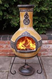 traditional clay chiminea decorative motifs patio furniture ideas outdoor fireoutdoor livingfireplace