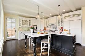 ... kitchen island with elegant detailing and a three seater table space  View ...