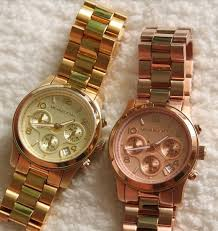 gold michael kors watch a gold michael kors watch