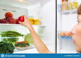 Refrigerator Light Out Woman Taking A Healthy Sandwich Out Of The Fridge Stock