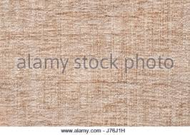 Light beige fluffy background of soft fleecy cloth Texture of