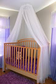 Wooden Crib Canopy Design Ideas With Transparent Curtain And Fluffy Rug At  Small Nursery ...
