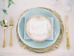 table place setting. gold flatware and light blue china wedding place setting table a
