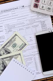 Time And Pay Calculator Composition Of Items Lying On The 1040 Tax Form Dollar